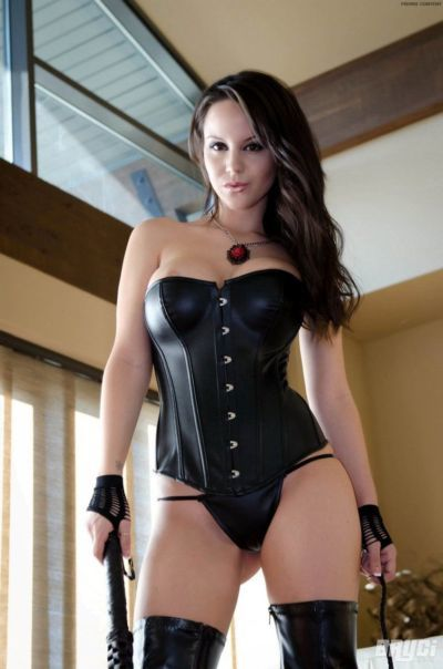 Amateur brunette looks wicked in leather bustier and thigh high boots