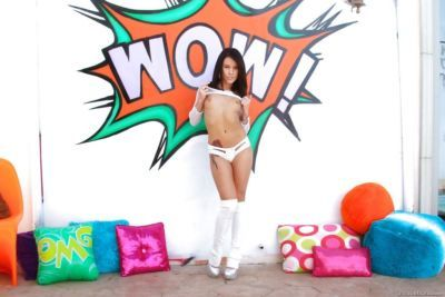 Teen pornstar Megan Rain showing off sexy butt in white stripper boots