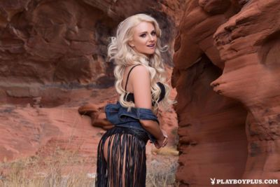 Centerfold Veronika Skylee climbs the desert rocks naked in high heel boots