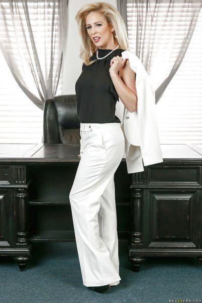 Blonde boss woman Cherie Deville peeling off her clothes atop office desk