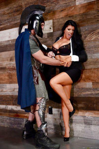 Famous pornstar Romi Rain baring bit tits for cosplay fuck in high heels
