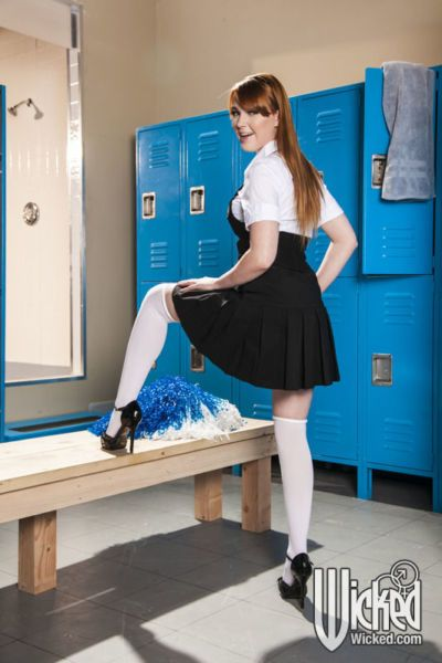 Naughty schoolgirl on high heels Marie McCray stripping in the locker room