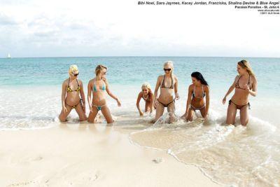Seductive amateur lesbians taking off their bikinis and having fun outdoor
