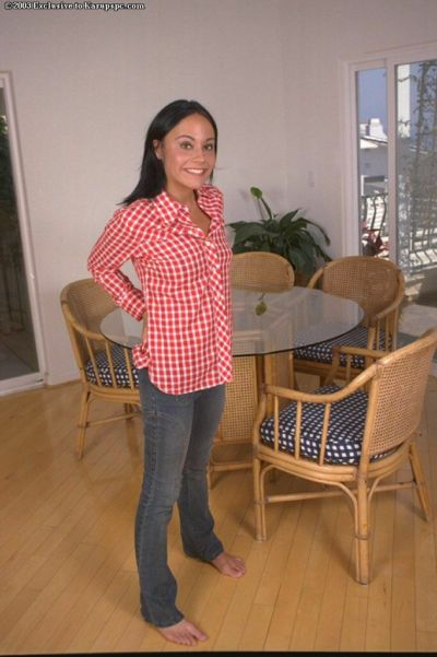 Tanned girl with small boobies Arlyn is showing off in her red shirt