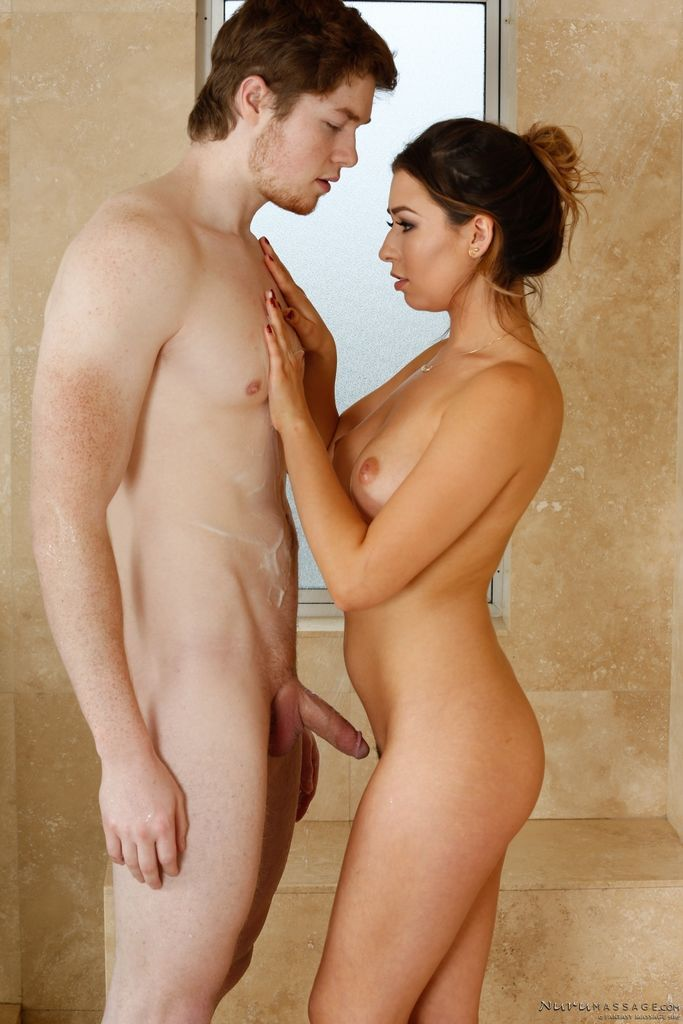 Asian masseuse Melissa Moore stroking a cock in the bathtub