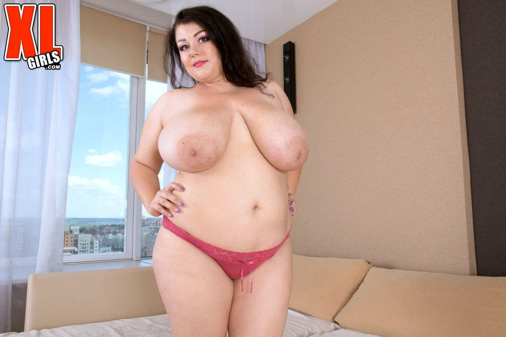 BBW woman Mariya Mills takes off her pink costume revealing huge boobs and ass