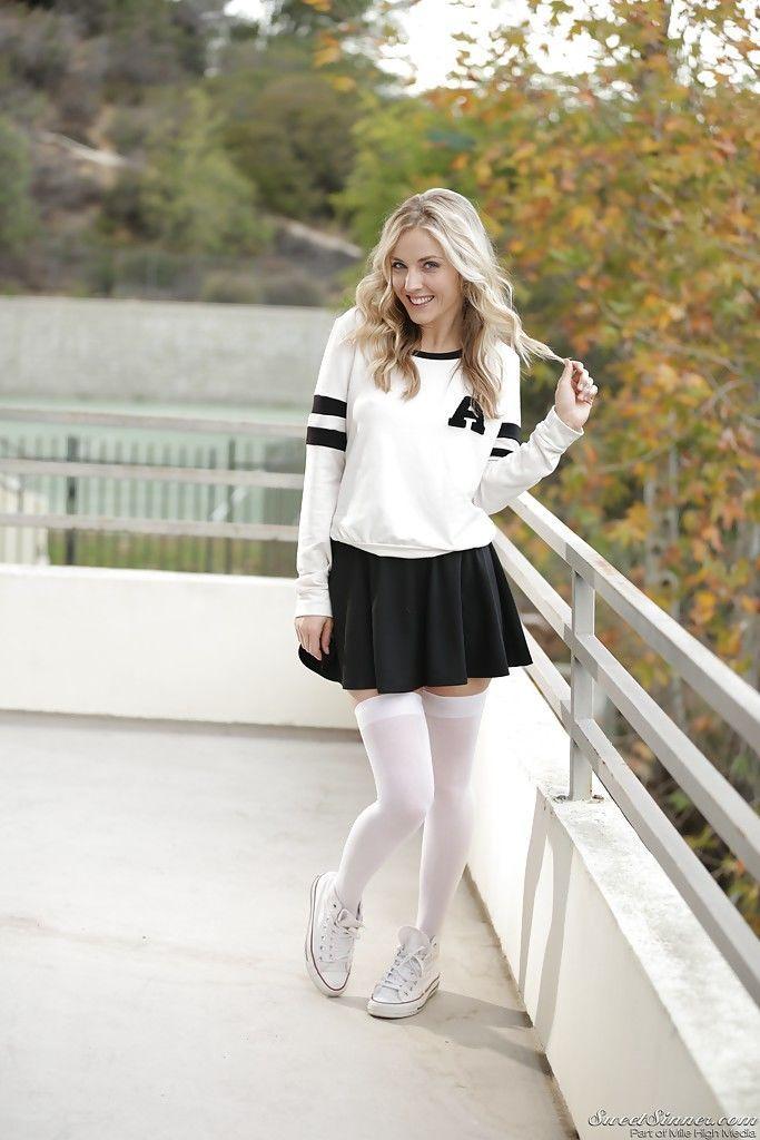 Blonde pornstar Karla Kush posing topless outdoors in schoolgirl uniform