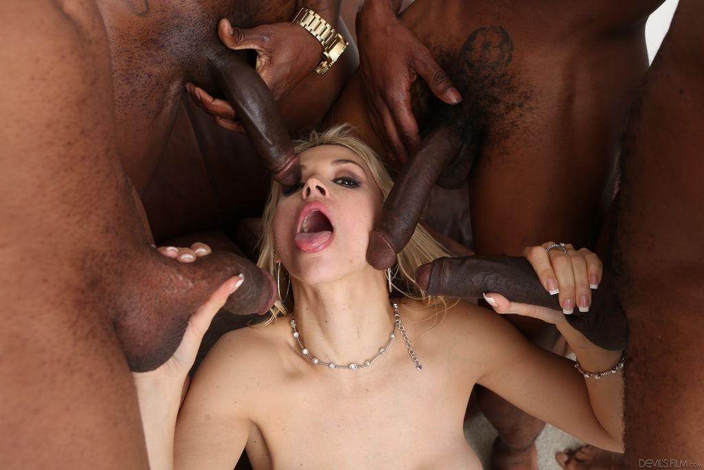 Blonde slut gets gangbanged hardcore by a few black dudes gets massive facial