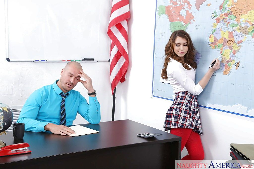 Teen pornstar Joseline Kelly giving teacher blowjob in schoolgirl uniform