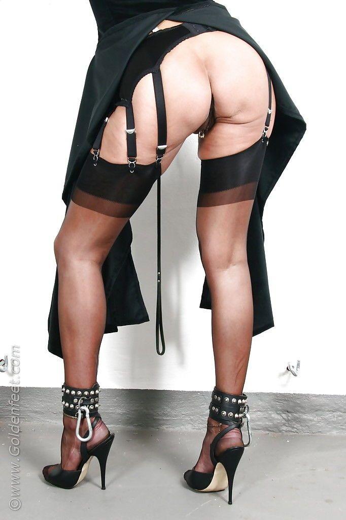 Kinky mature UK BDSM model Lady Sarah flashing pierced upskirt pussy