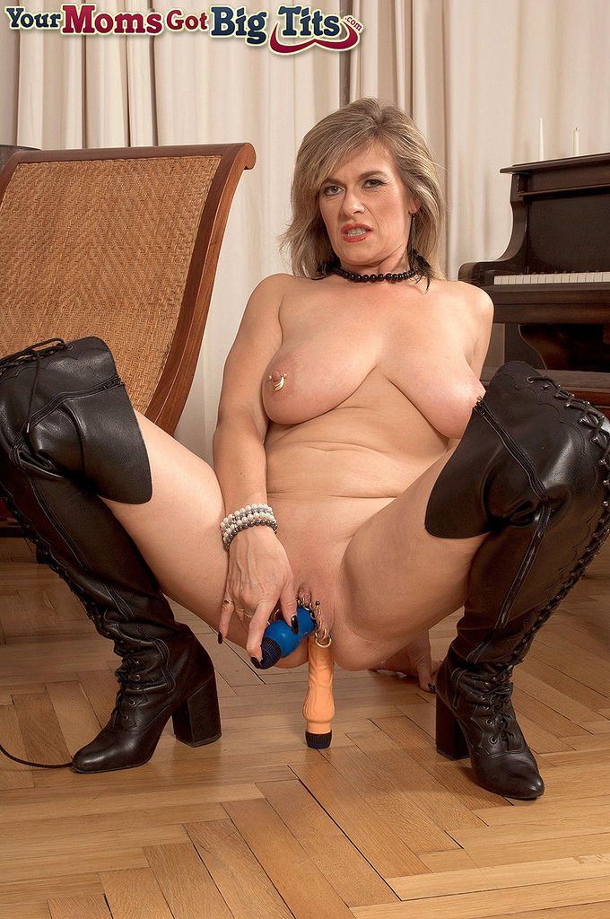 BBW mature model Marina Rene stuffs her piereced cunt and asshole with toys