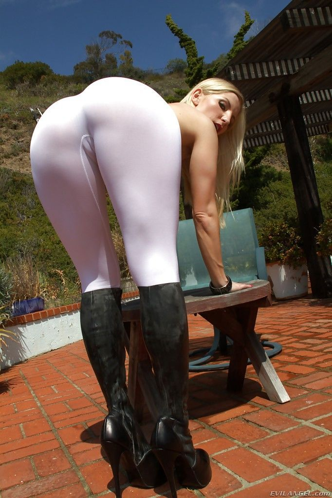 Sexy babe Ashley Fires uncovering her big ass and sweet pussy outdoor