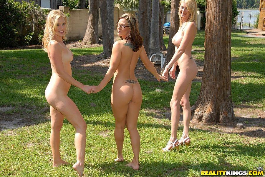 Three lesbian MILFs flaunting nude outdoor