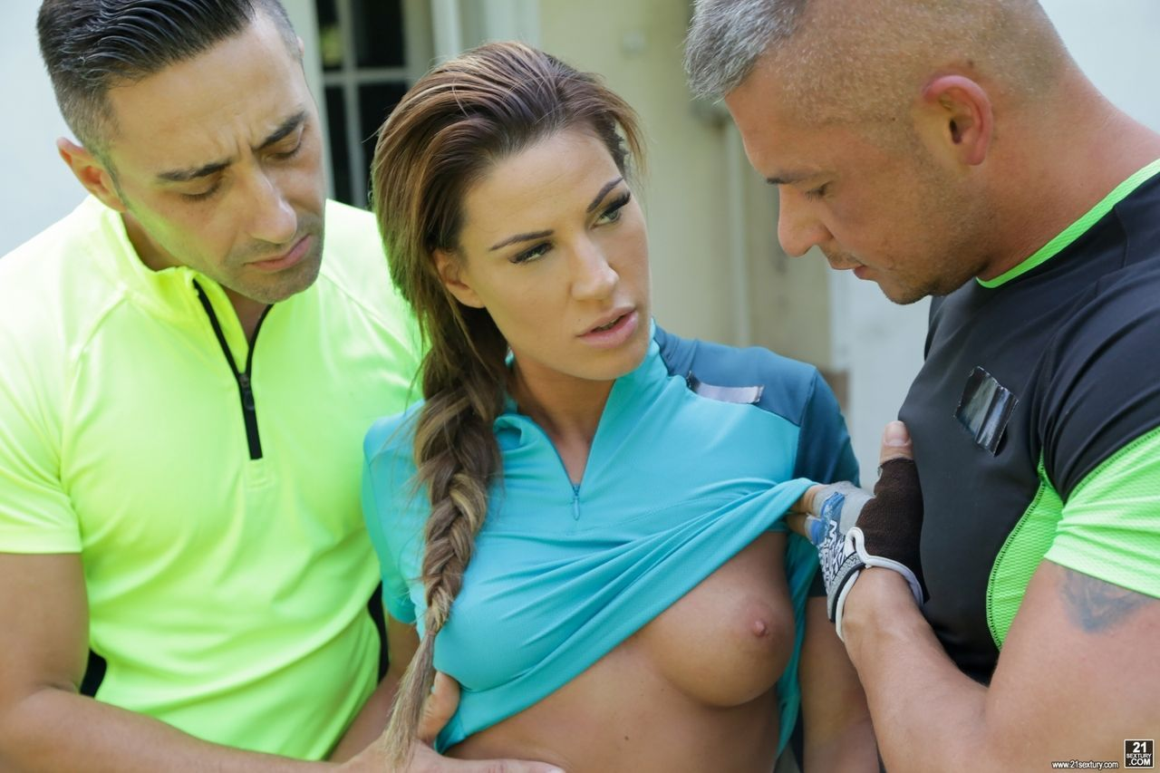 Female bicyclist in spandex shorts gets it on with two guys at once