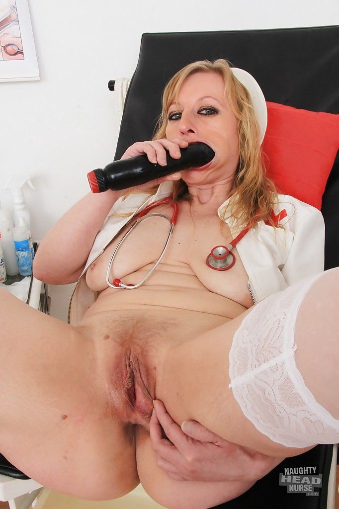 Mature blonde Susan Blond is penetrating herself with a red dildo