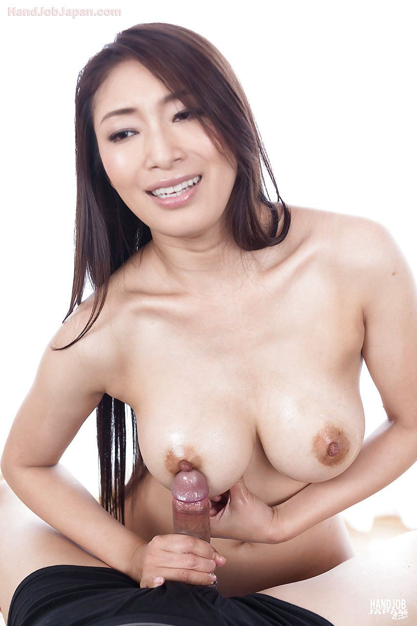 Sexy Japanese girl giving sloppy handjob and licking up dripping cum