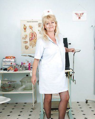 Bawdy granny in nurse uniform revealing her rack and soaking wet cunt