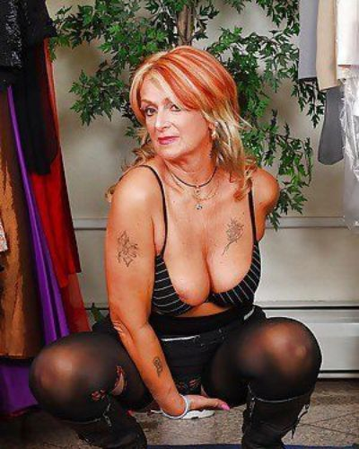 Lustful granny in stockings Joanna Depp uncovering her fuckable body