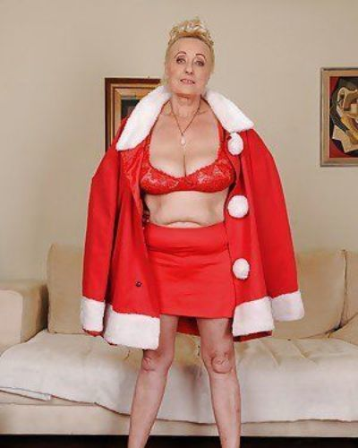 Lecherous granny with massive flabby jugs stripping off her clothes