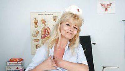 Filthy granny in nurse uniform masturbating her twat with toys