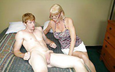 Slutty granny in glases jerking off a dicks and getting a facial cumshot
