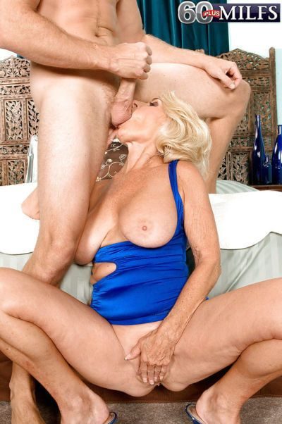 Granny with blond hair sucks balls and licks a huge cock of a young dude - part 2