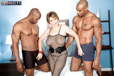 Dirty-minded granny in a fishnet Bea Cummins fucks with two black fellows