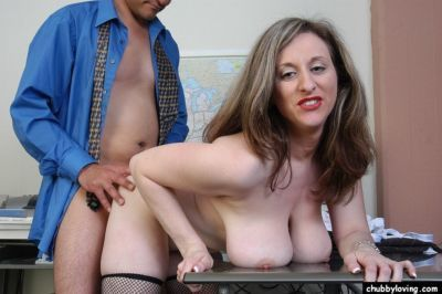 Older broad Kitty having sex with co-worker in office wearing mesh stockings - part 2