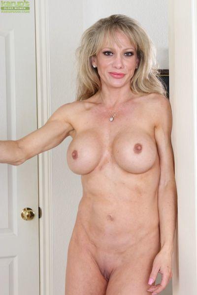 Older blonde model Christina Brim exposing her huge clit for close ups - part 2