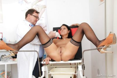 Beauty brunette in stockings is lying in front her lovely gyno doc - part 2