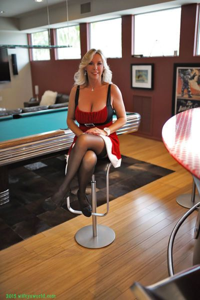 Blonde housewife Sandra Otterson striking hot Christmas themed solo poses