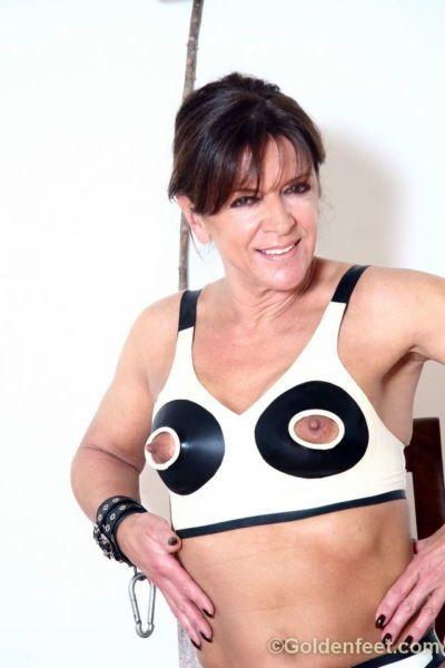 Kinky European woman Lady Sarah posing in nippleless bra and handcuffs