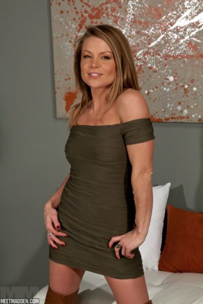 Smoking hot mature stunner Meet Madden teases with her tight body