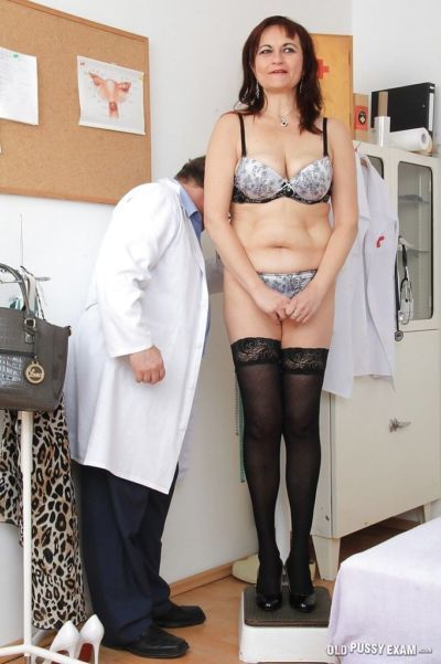 Older woman Remy strips down to underwear and stockings in doctors office