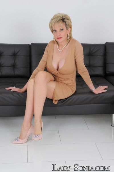 Hot older lady Lady Sonia pulls her large tits out of her dress