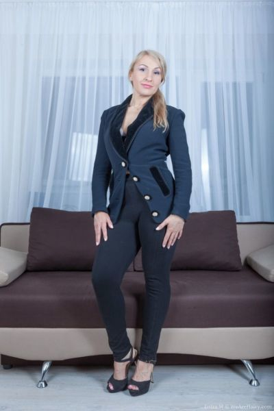 Mature woman Luiza M doffs her suit to spread her very hairy beaver wide open
