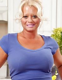 Chubby blond housewife Roxie Doll gets naked on kitchen counter during the day