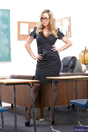 Sexy teacher in glasses Brandi Love getting nude in the classroom