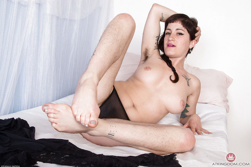 Hairy mature model Stacey Stax showing off her furry underarms