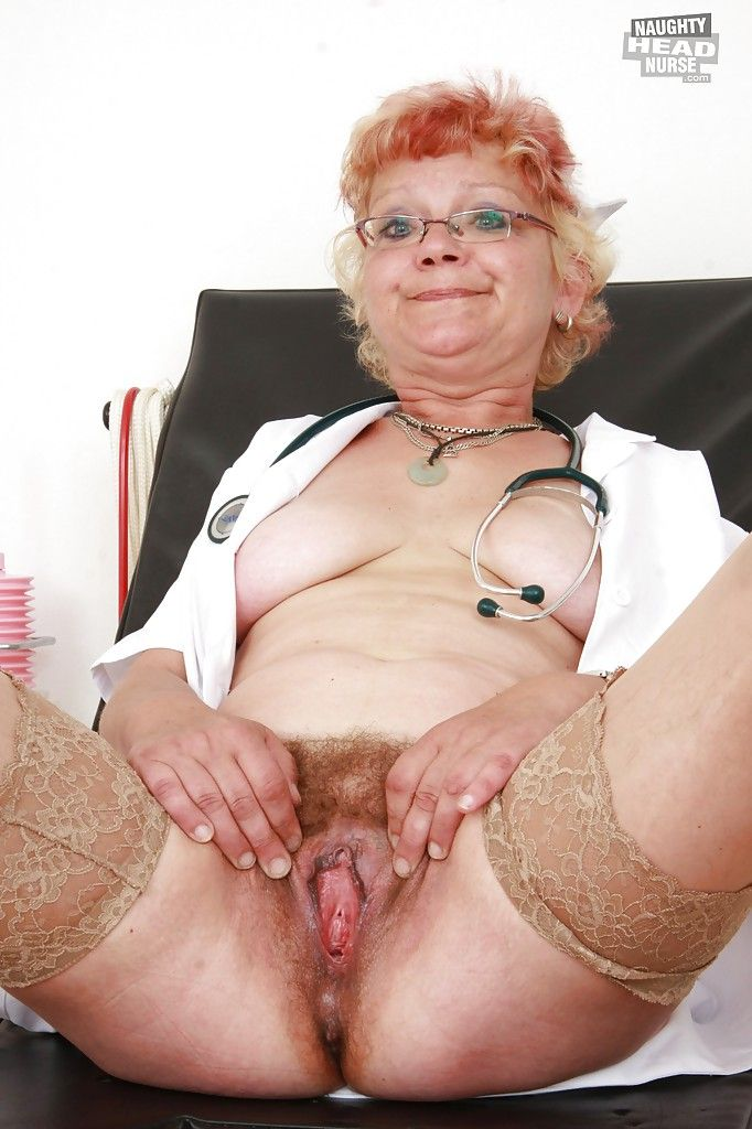 Filthy granny in nurse uniform stretching her twat by her fingers