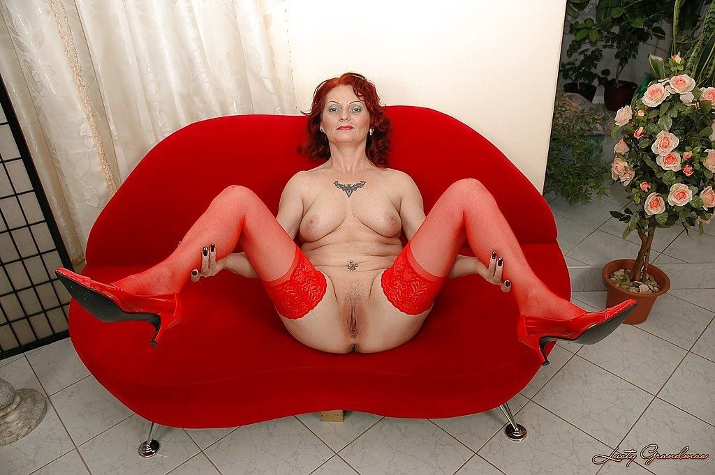 Fuckable redhead granny in stockings stripping off her red lingerie - part 2