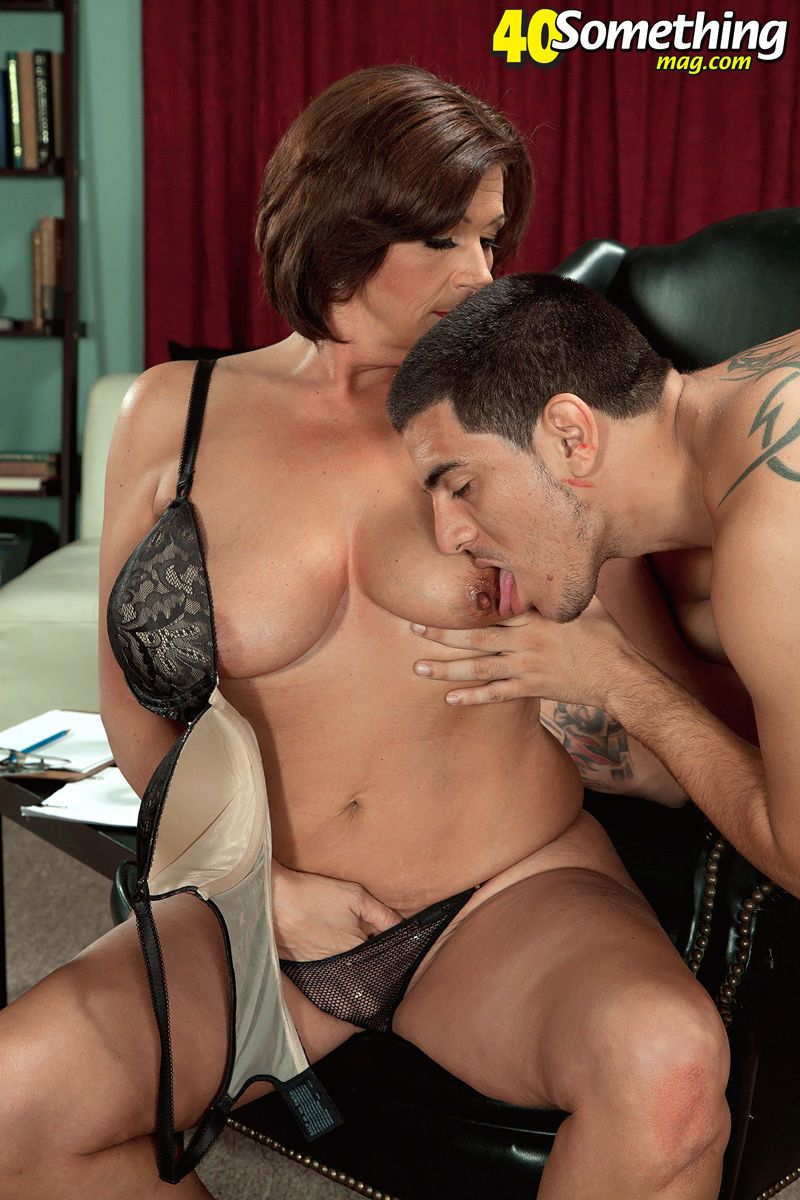 Middle aged woman Yasmine Beale seducing her male patient in her office - part 2