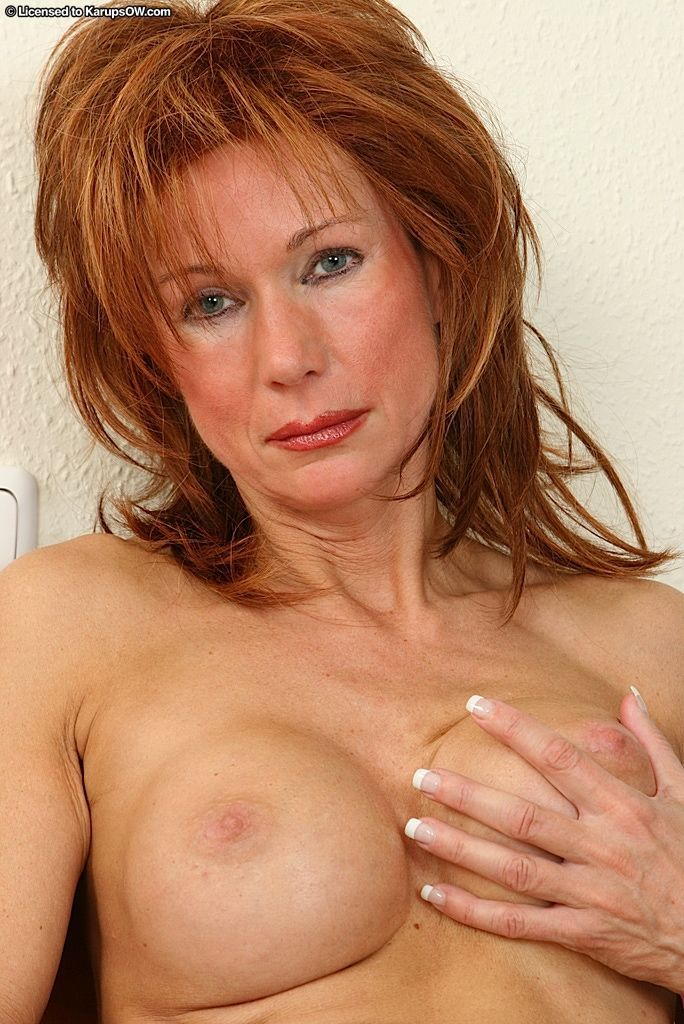 Busty mature gal in jeans undressing and fingering her cunt in close up - part 2