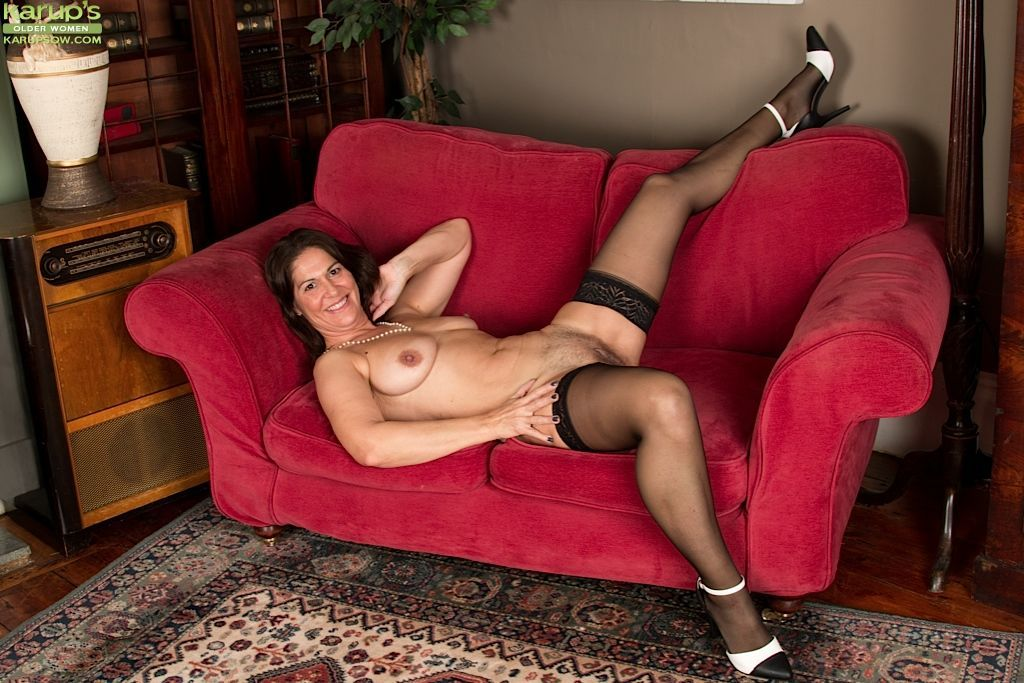 Nylon attired mature babe unveils saggy tits and hairy pussy