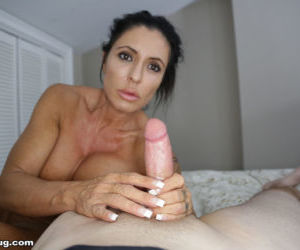 Mature mom Mrs Simone jacks off a big cock in the nude..