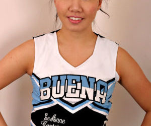 Amateur Asian solo girl sheds cheerleader uniform to bare..