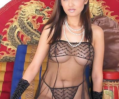 Big tits Asian babe reveals her hairy cunt in a sexy lingerie