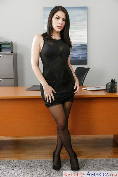 Gorgeous European brunette Valentina Nappi posing naked in stockings on desk