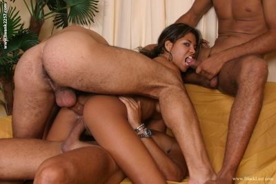 Sexy ebony babe Milla Morena is into foursome groupsex with white guys