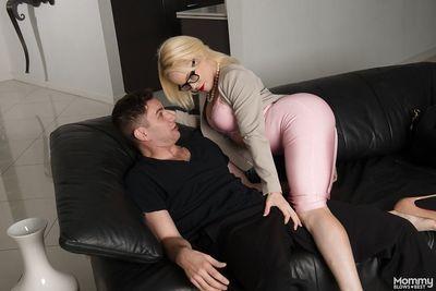Blonde cougar Nikki Delano displaying big tits while giving BJ in glasses